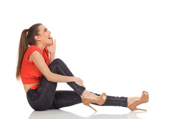 Shouting girl sitting on the floor