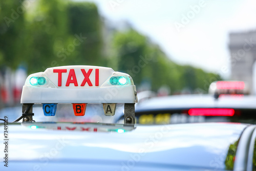 canvas print picture Parisian taxi in the city