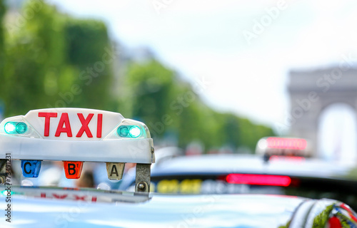 Parisian taxi in the city - 73491231