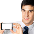 Businessman showing blank cellphone