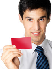 Businessman giving blank red card, on white