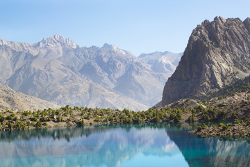sunny landscape with pond in central Asia mountains, Tajikistan