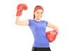 Beautiful girl with boxing gloves posing