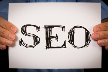 Person holding SEO sign