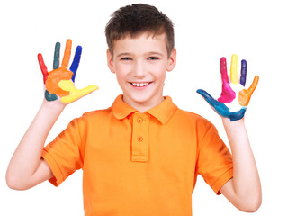 Happy smiling boy with a painted hands.