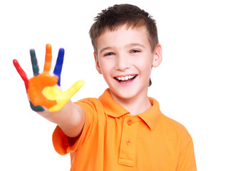 Happy smiling boy with a painted hand.