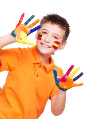 Happy smiling boy with a painted hands and face.