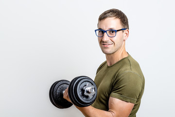 Young Man Trains His Arms