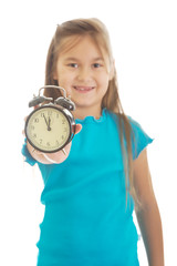 Girl holding the clock
