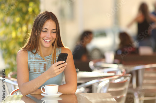 Girl texting on the phone in a restaurant poster