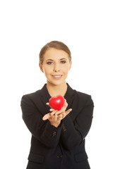 Businesswoman holding heart