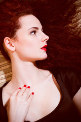 young woman redhead girl with red lips