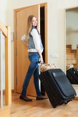 positive woman in jeans  leaving the home
