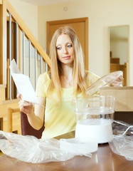 woman reading user manual