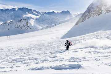 Young skier downhill on the ski slope
