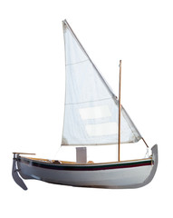 Small boat with sails unfurled