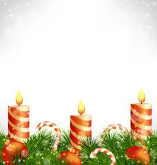 Three burning orange Christmas candles with Christmas balls, can