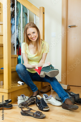 canvas print picture Happy blonde girl cleaning shoes