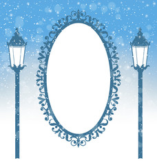 Two winter lampposts and frame with ornament in snowfall on ligh