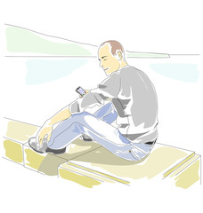 Man with mobile phone sitting on the parapet on the seaside