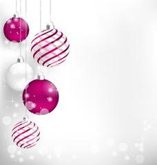 Pink Christmas spiral balls hang in snowfall