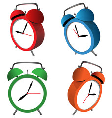 Four multicolored alarm clocks isolated on white background