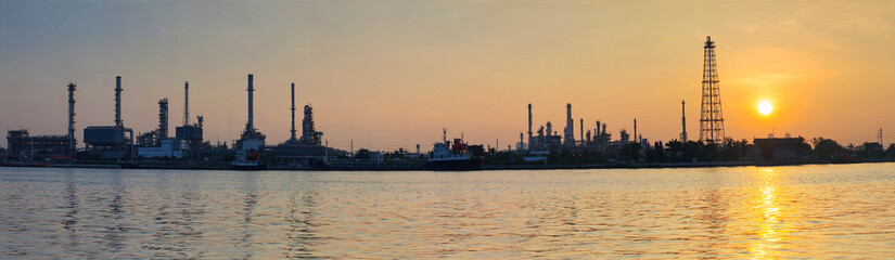 beautiful sun rising scene with oil ,gas refinery industry estat