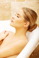 Portrait of a woman relaxing in bathtub