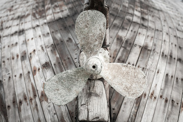 Old wooden fishing boat propeller