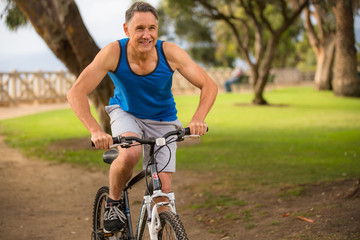 Man riding his mountain bike at the park