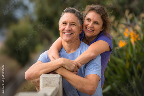 Portrait of an elder couple in a park - 73498424