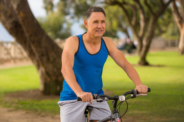 Fit mature male riding a bicycle