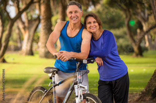 Senior couple happy in the park - 73498844