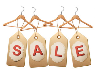 Four wooden hangers with price tags forming the word Sale. Disco