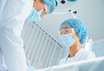 Surgeon and assistant in operating room