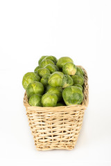 Basket full of brussel sprouts isolated on white
