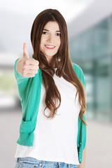 Teen girl gesturing thumbs up