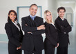 Confident Business Team Standing In Office