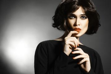 Woman with black hair style Brunette fashion model portrait