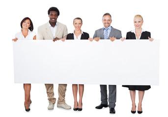 Multiethnic Business People Holding Large Billboard