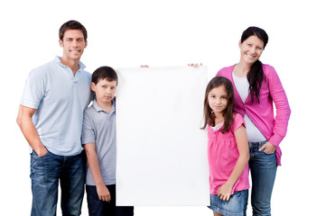 Portrait Of Happy Family Holding Blank Banner