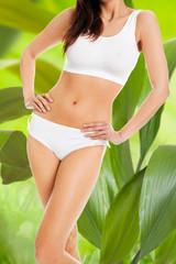 Slim Woman In Innerwear Standing Against Leaves
