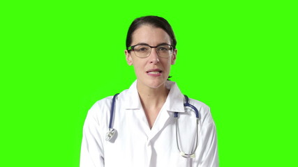 Smiling doctor on green screen