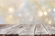 rustic wood table in front of glitter silver and gold bright bok - 73503862
