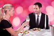 Couple Toasting Champagne Flutes At Restaurant Table