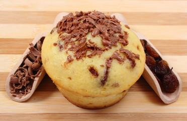 Fresh baked muffins, grated chocolate and raisins