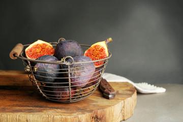 Ripe sweet figs in metal basket,