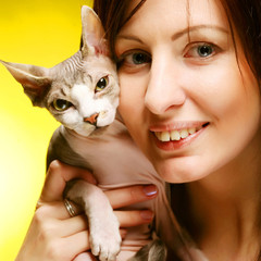 young woman with fun sphynx  cat