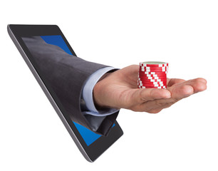 Hand Holding Poker Chips Coming From Tablet