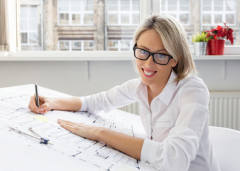 Portrait of young professional woman architect at work